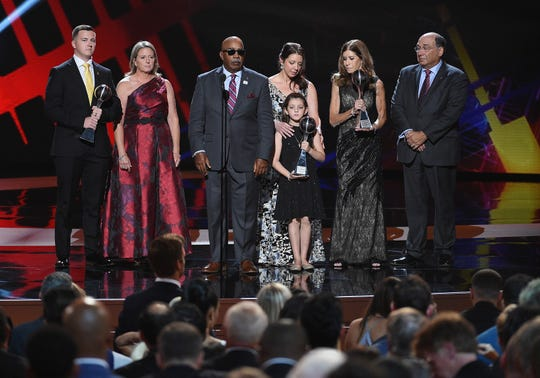Marjory Stoneman Douglas High School coaches Aaron Feis, Scott Beigel and Chris Hixon are posthumously given the Coach of the Year award, accepted by family members and fellow coach Elliott Bonner onstage at The 2018 ESPYS at Microsoft Theater on July 18, 2018 in Los Angeles, California.  (Photo by Kevork Djansezian/Getty Images)