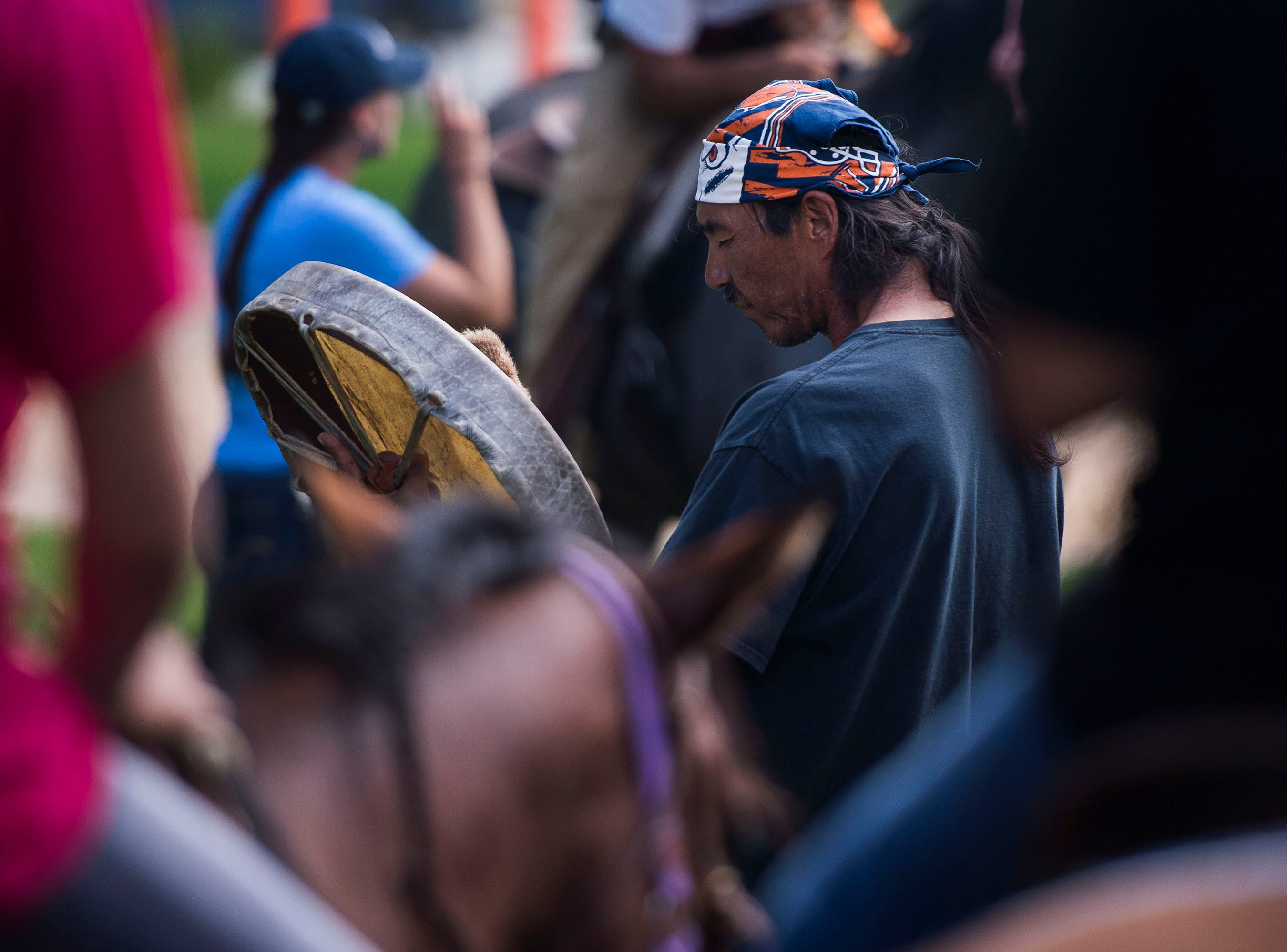 Northern Arapaho and Lakota tribe member Terry Spoonhunter performs a sacred drum prayer before the LakotaRide 2018 riders head north to Fort Collins on Thursday, July 19, 2018, at Namaqua Park in Loveland, Colo.