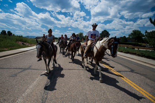 From left, Sierra, Dave and Adam Ventimiglia lead the LakotaRide 2018 as they head through Loveland on their way to Namaqua Park on Thursday, July 19, 2018, in Loveland, Colo.