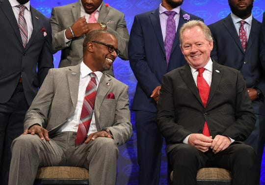 Florida State head coach Willie Taggart, left, talks with Louisville head coach Bobby Petrino while waiting on the Atlantic Division group photo at the ACC Football Kickoff in Charlotte, N.C., Thursday, July 19, 2018.