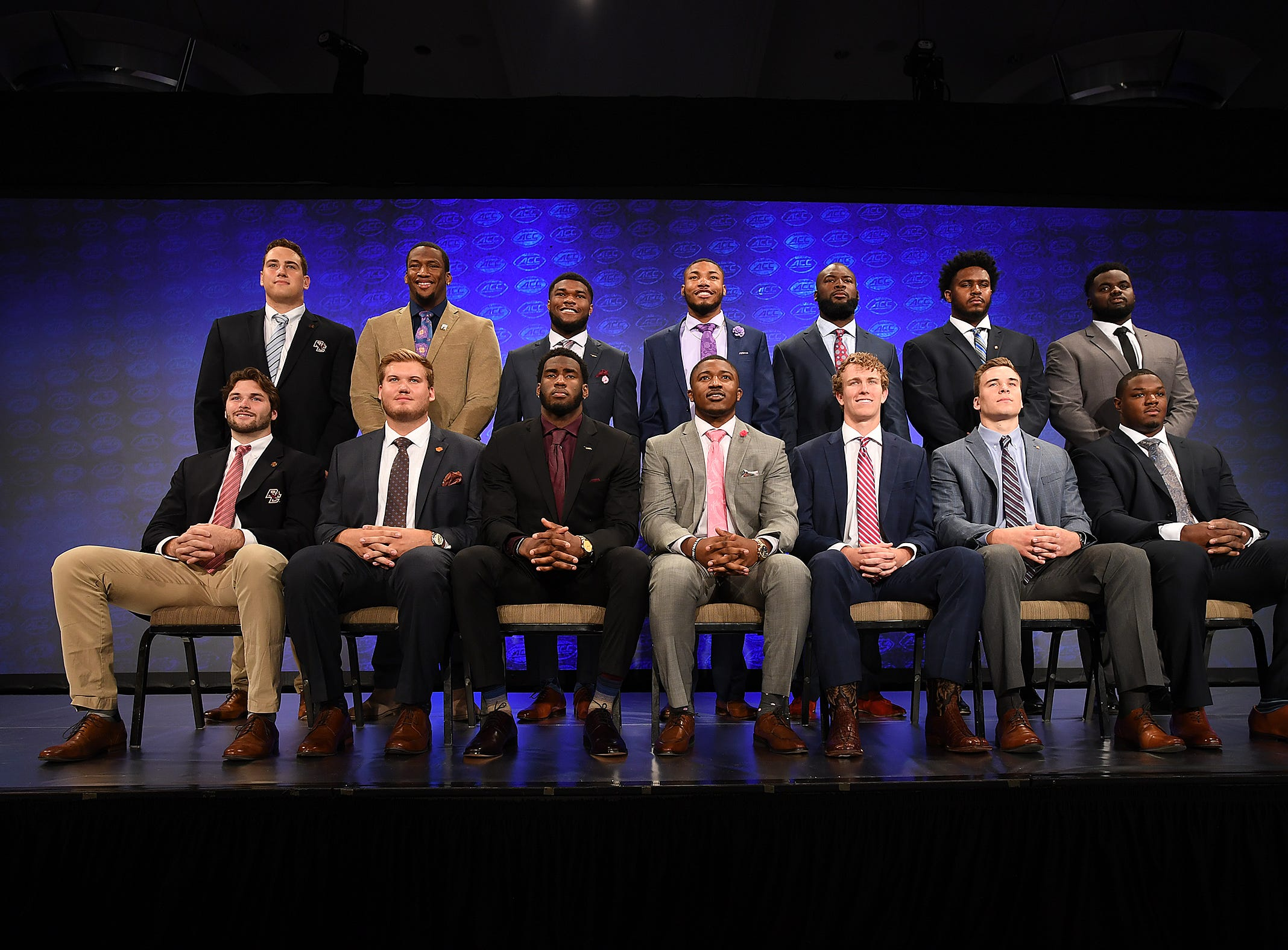 Players from the Atlantic Division pose for a group photo at the ACC Football Kickoff in Charlotte, N.C., Thursday, July 19, 2018.