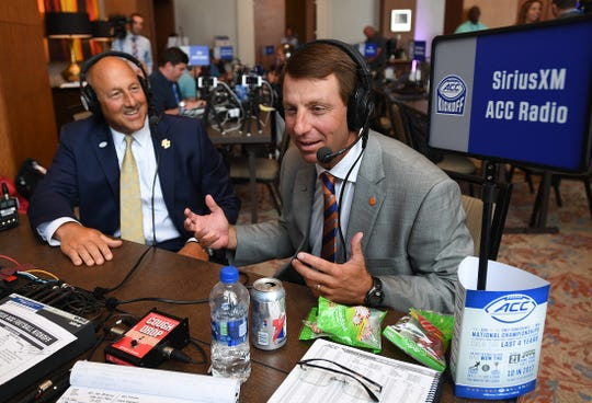 Clemson head coach Dabo Swinney, right, and Boston College head coach Steve Addazio are interviewed on radio row at the ACC Football Kickoff in Charlotte, N.C., Thursday, July 19, 2018.