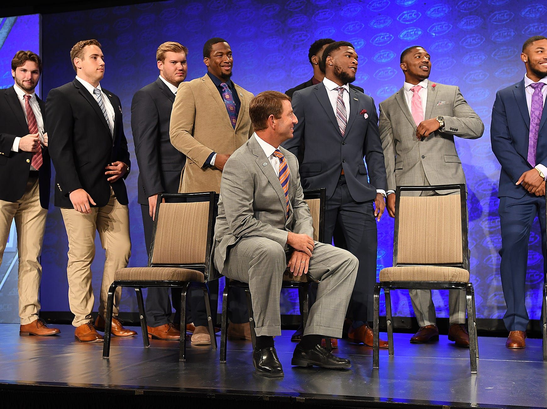 Clemson head coach Dabo Swinney waits on the Atlantic Division group photo at the ACC Football Kickoff in Charlotte, N.C., Thursday, July 19, 2018.