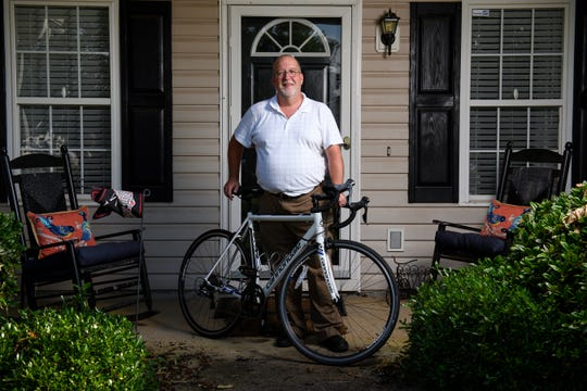 Keith Moreland poses for a portrait with his bicycle at his home in Anderson on Tuesday, July 18, 2018. Moreland, who was recently diagnosed with early onset Alzheimer's, rode his bike 134 miles in the Alzheimer's Ride to Remember to raise awareness and money for the neurodegenerative disease.
