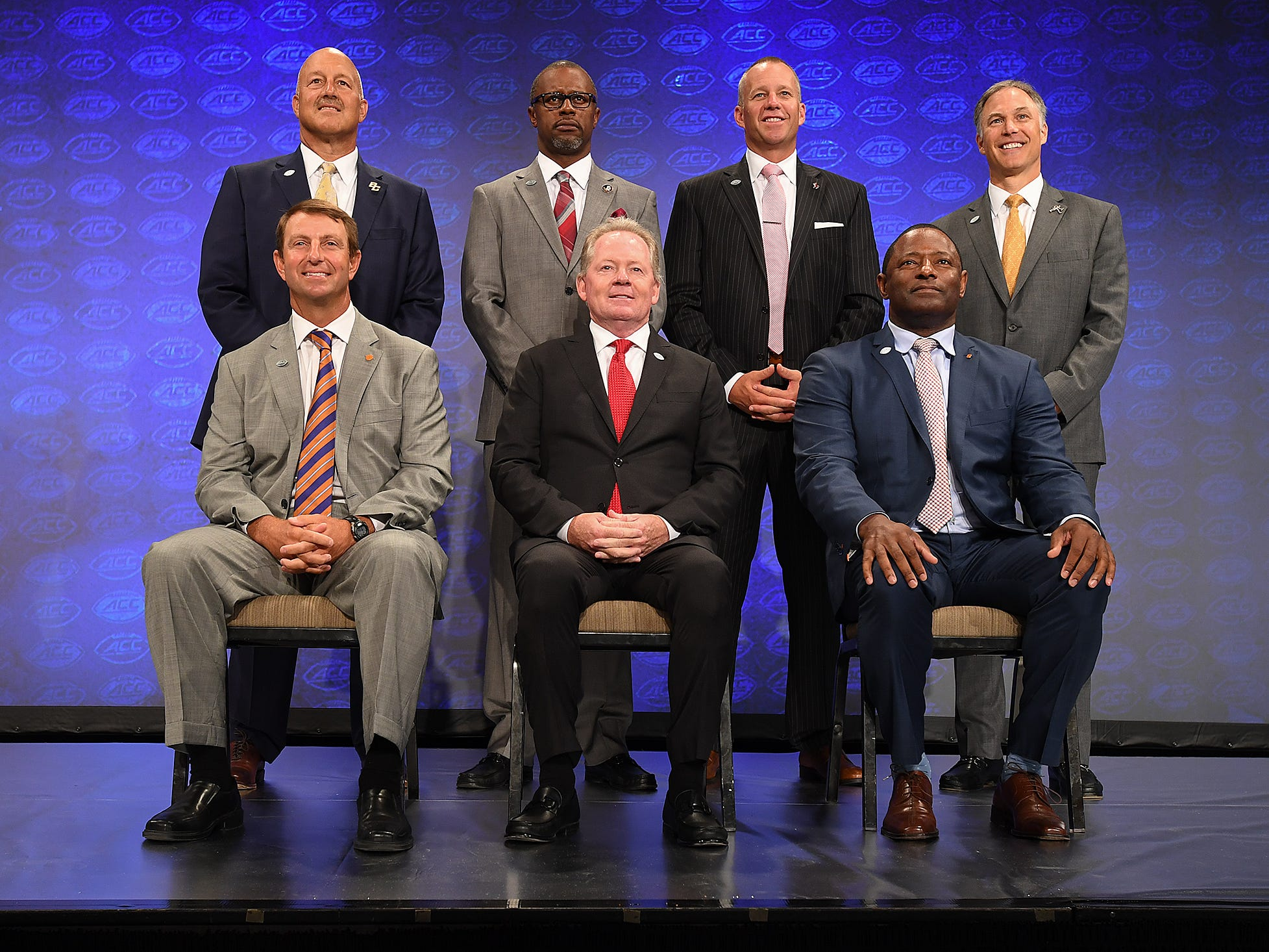 Coaches from the Atlantic Division pose for a group photo at the ACC Football Kickoff in Charlotte, N.C., Thursday, July 19, 2018.