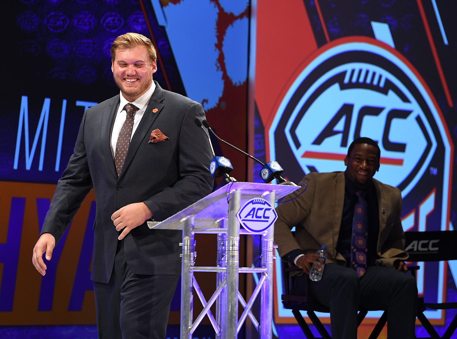 Clemson offensive lineman Mitch Hyatt  laughs as he walks to the podium at the ACC Football Kickoff in Charlotte, N.C., Thursday, July 19, 2018.