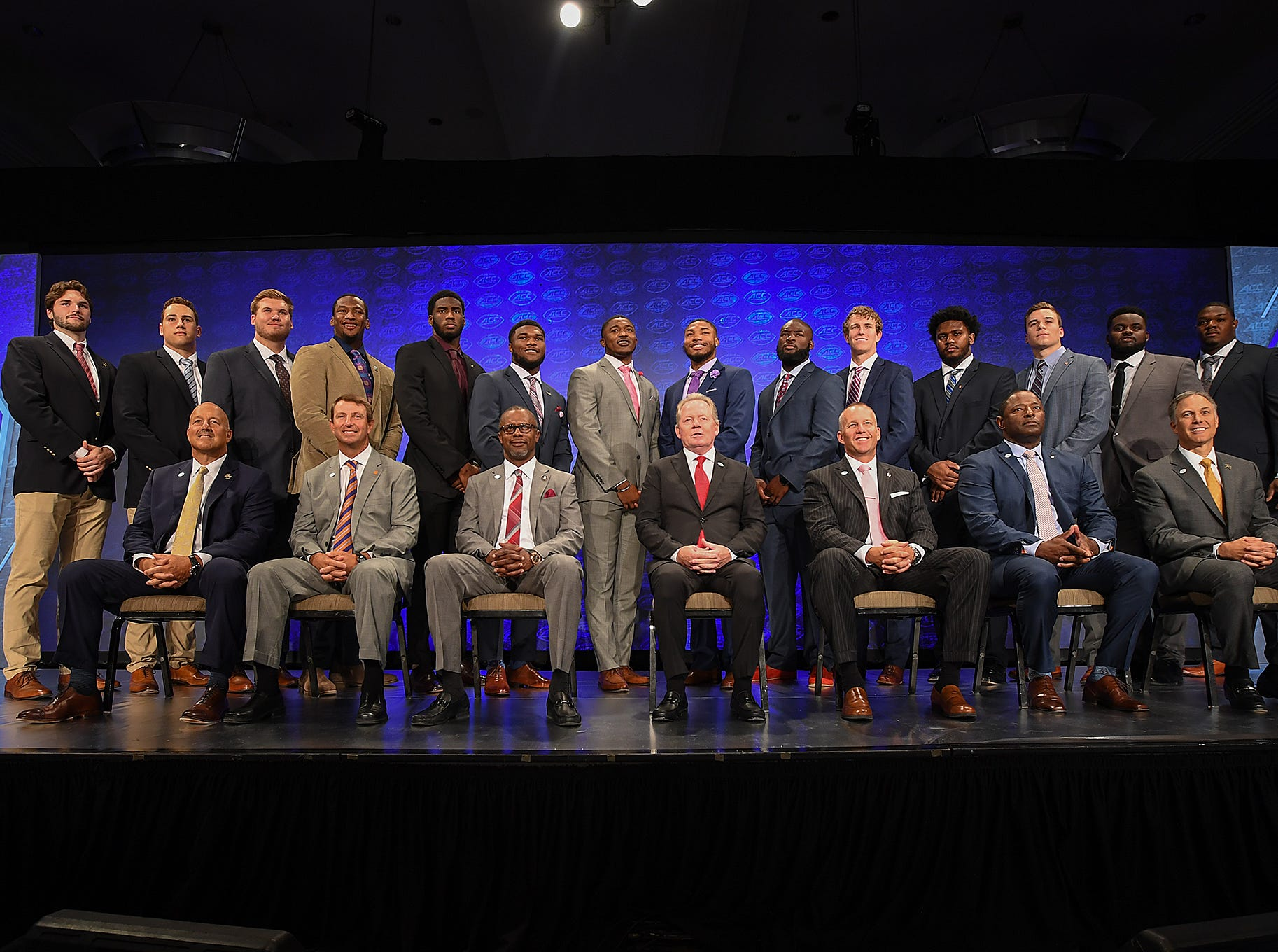 Players and coaches from the Atlantic Division pose for a group photo at the ACC Football Kickoff in Charlotte, N.C., Thursday, July 19, 2018.