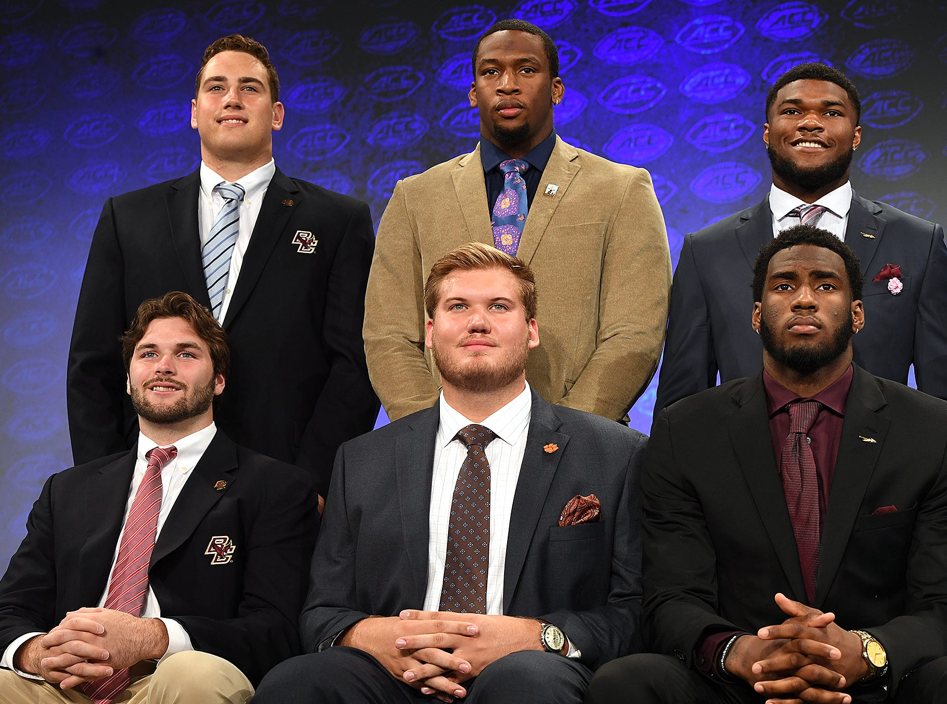 Clemson's Mitch Hyatt, front center, and Clean Ferrell pose for the Atlantic Division group photo at the ACC Football Kickoff in Charlotte, N.C., Thursday, July 19, 2018.