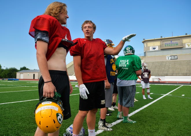 CMR QB Garrison Rothwell, left, talks with Treyton Pickering of Sunburst during the East team's practice at Memorial Stadium on Thursday. The Montana East West Shrine Game will take place Saturday at 7 p.m. at Memorial Stadium.