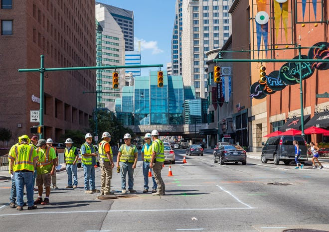 The intersection of Illinois and West Maryland streets are closed in downtown Indianapolis due to a collapsed manhole and sinkhole under the street on Thursday, July 19, 2018.