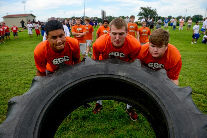 South Gibson linemen, including Spencer Lacewell, center, compete in the Fellowship of Christian Athletes  7 on 7 and big man challenge at Trinity Christian Academy in Jackson, Tenn., Wednesday, July 18, 2018.