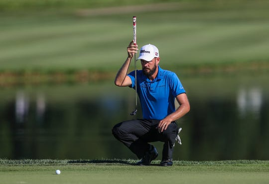 Troy Merritt sizes up his putt on the ninth green. Through Thursday evening, he was -10 under for the first day lead, overtaking Andres Romero and setting a Barbasol Championship record.