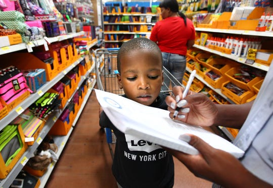 Jul 31, 2015 - Cameron Johnson, 6, goes back-to-school shopping with his mother Charmise Johnson. Teachers in Memphis and around the country are sharing Amazon wishlists with the hashtag #ClearTheLists in hopes of receiving supplies via donations. (File photo)