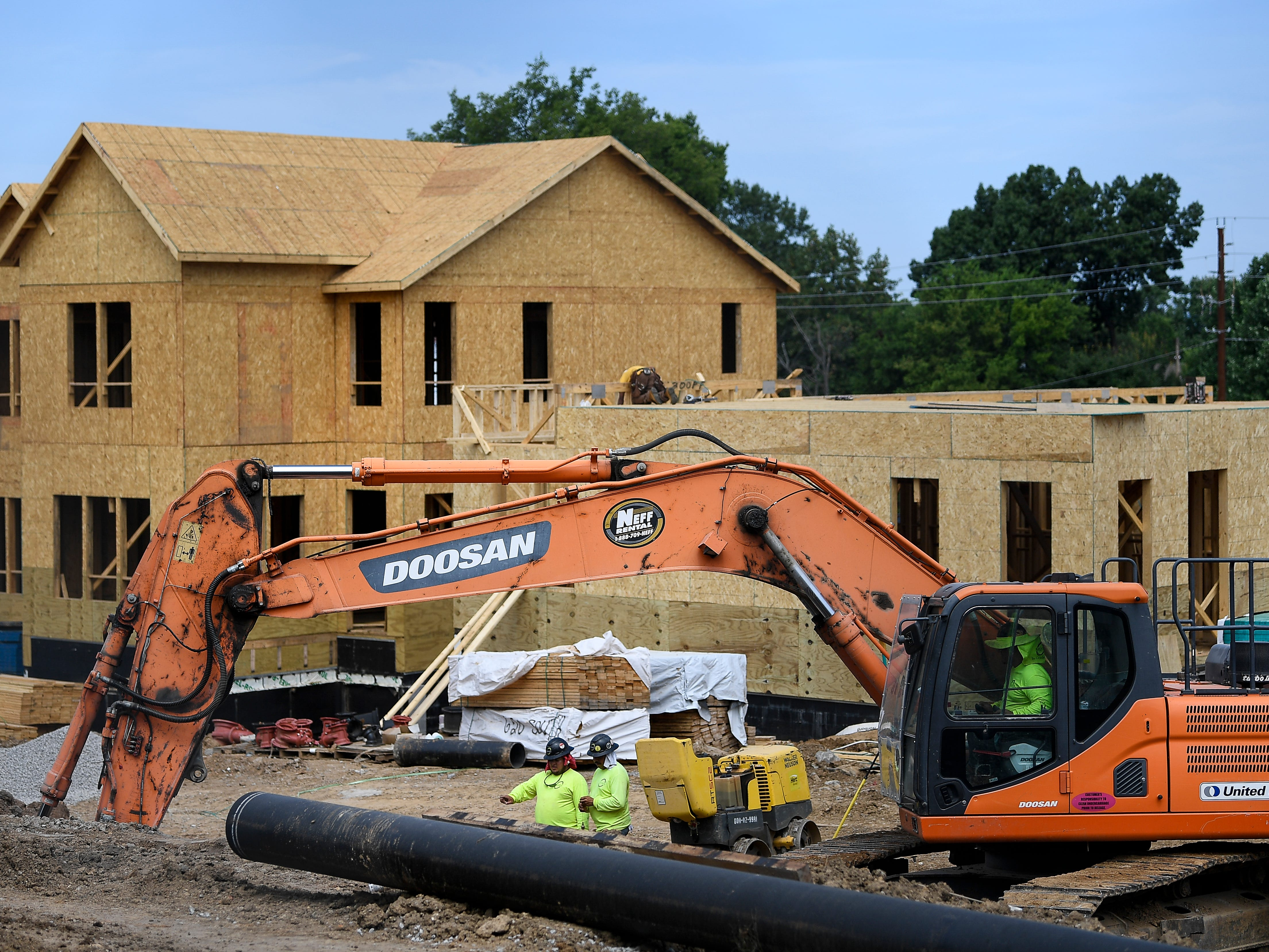 Construction workers build new housing at the James Cayce Homes for a new MDHA project called Envision Cayce Wednesday, July 18, 2018, in Nashville, Tenn.