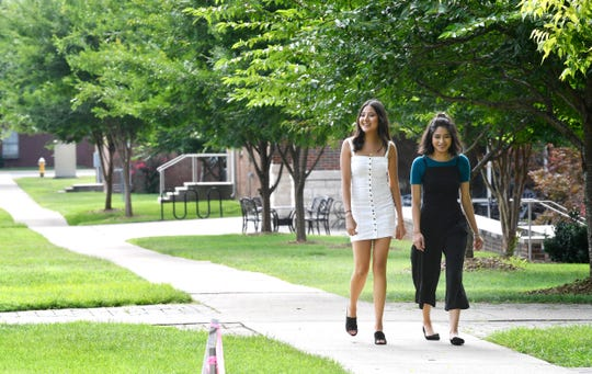Andrea Chavez, left, walks across Cumberland University campus with fellow sophomore Heidi Estrada.