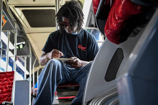 Charles Chesney works on his art as he rides the bus from Antioch to his job in Nashville on Saturday, July 7, 2018.