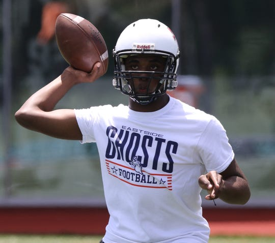 Eastside quarterback Wymeir Reed drops back to pass against JFK Paterson during a 2018 scrimmage.