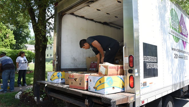 Table to Table delivers surplus food from ShopRite in Wallington to First Seventh Day Adventist Church Food Pantry in Montclair. Bruno Facundo, a driver with Table to Table, helps unload the truck on Thursday June 21, 2018.