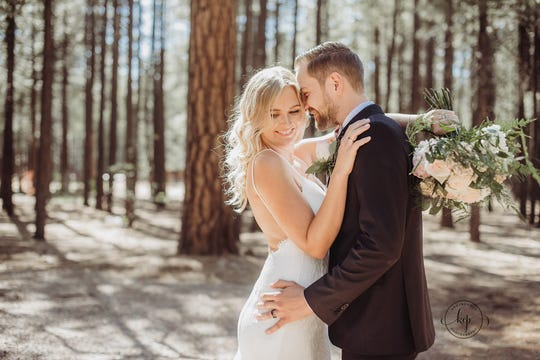 Tempe couple Heidi and Valentin Zherelyev  pose for a photo in Pinetop just before their wedding on June 30, 2018.