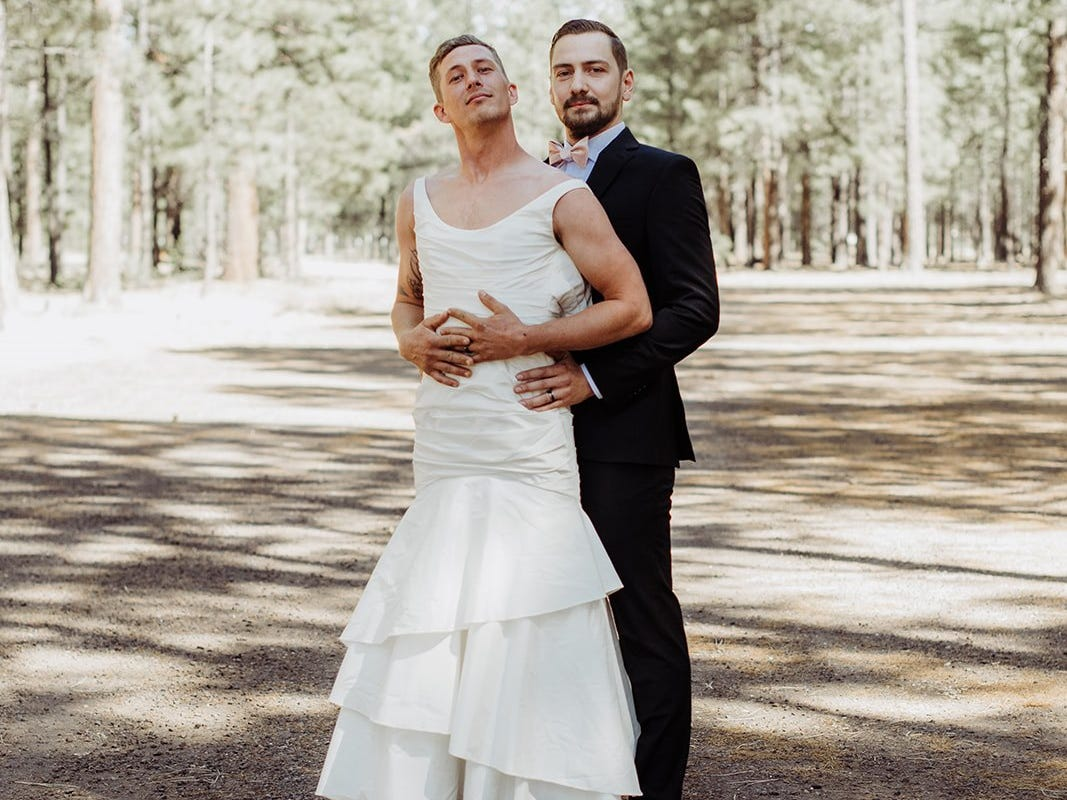 "Eric Dodds, brother of the bride, poses with Tempe groom Valentin Zherelyev during the ""first look"" photos just before a wedding in Pinetop on June 30, 2018."