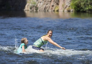 Campbell Merryman, 11, plays with her mom, Elizabeth, of Gilbert, in the Salt River at Blue Point in the Tonto National Forest on July 19, 2018.
