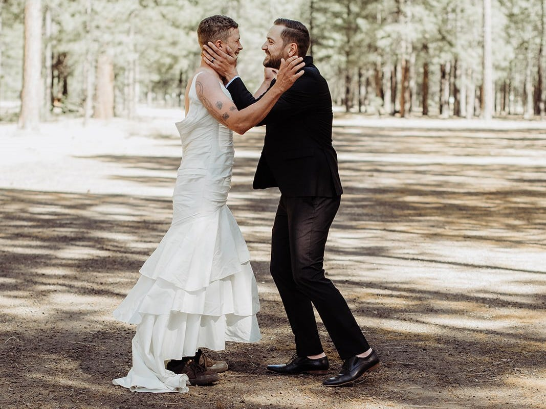 "Eric Dodds, brother of the bride, surprises Tempe groom Valentin Zherelyev during the ""first look"" photos just before a wedding in Pinetop on June 30, 2018."