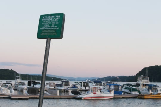 A sign indicating the location of a wet weather discharge point along the Hudson River near Shadows Marina in the City of Poughkeepsie on July 18, 2018.