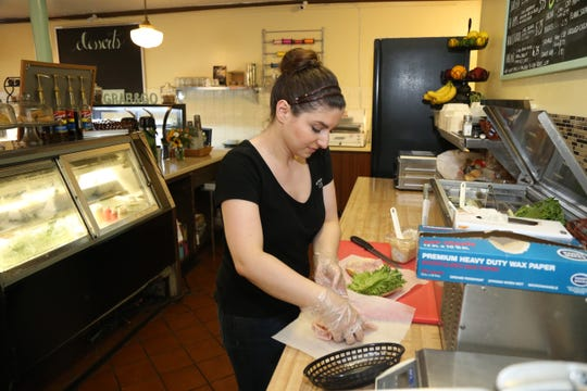 Owner, Gina Vaccarino prepares a customer's order at the Cake Artist Cafe in New Paltz on July 17, 2018.