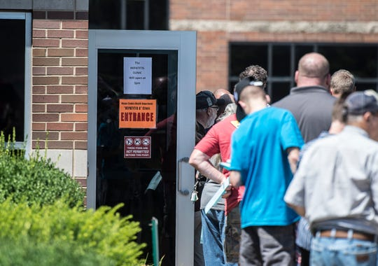 People wait in line to receive Hepatitis A vaccines during a clinic at the Wayne County Health Dept. on Thursday, July 19, 2018.
