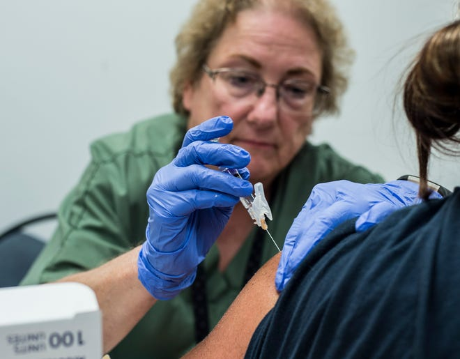 A woman receives a hepatitis A vaccine during a clinic at the Wayne County Health Dept. on Thursday, July 19, 2018.