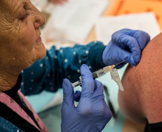 A Hepatitis A vaccine is administered during a clinic at the Wayne County Health Dept. on Thursday, July 19, 2018.