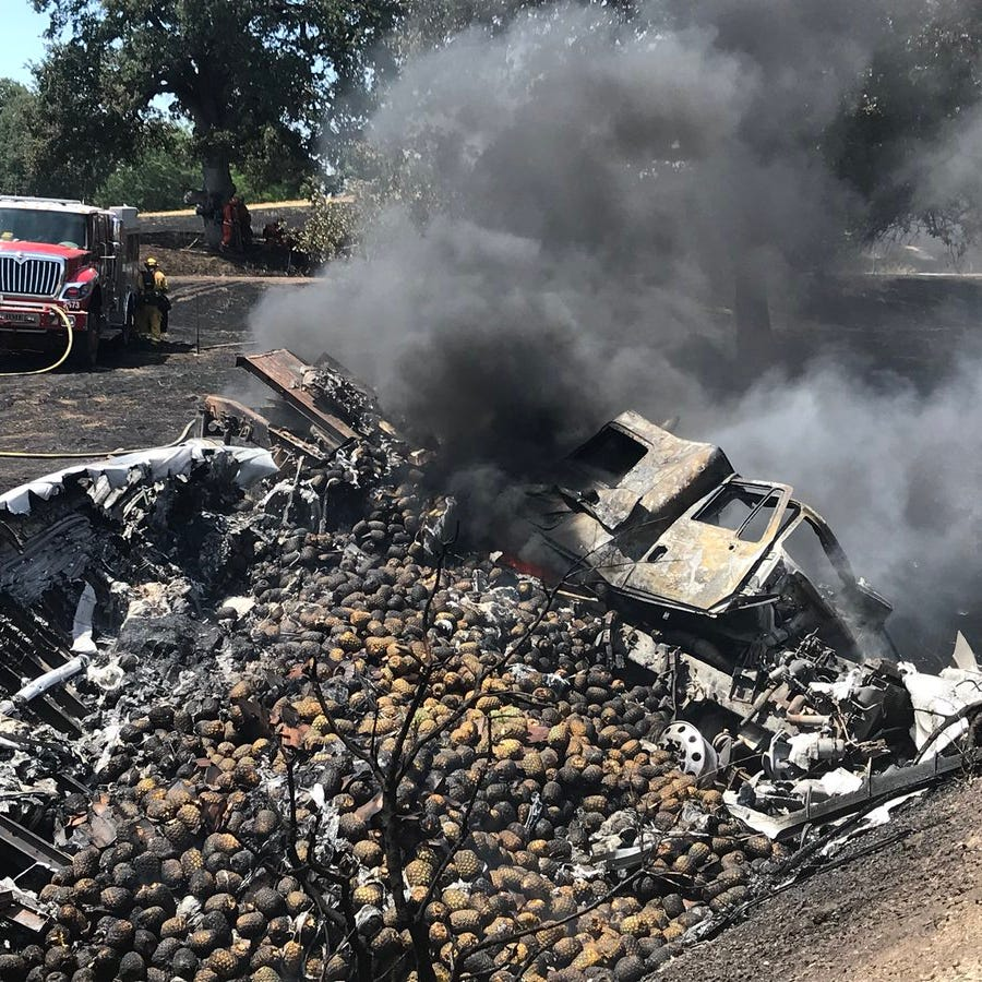 Truck flips, spills pineapples, burns up on I-5 near Jellys Ferry Road