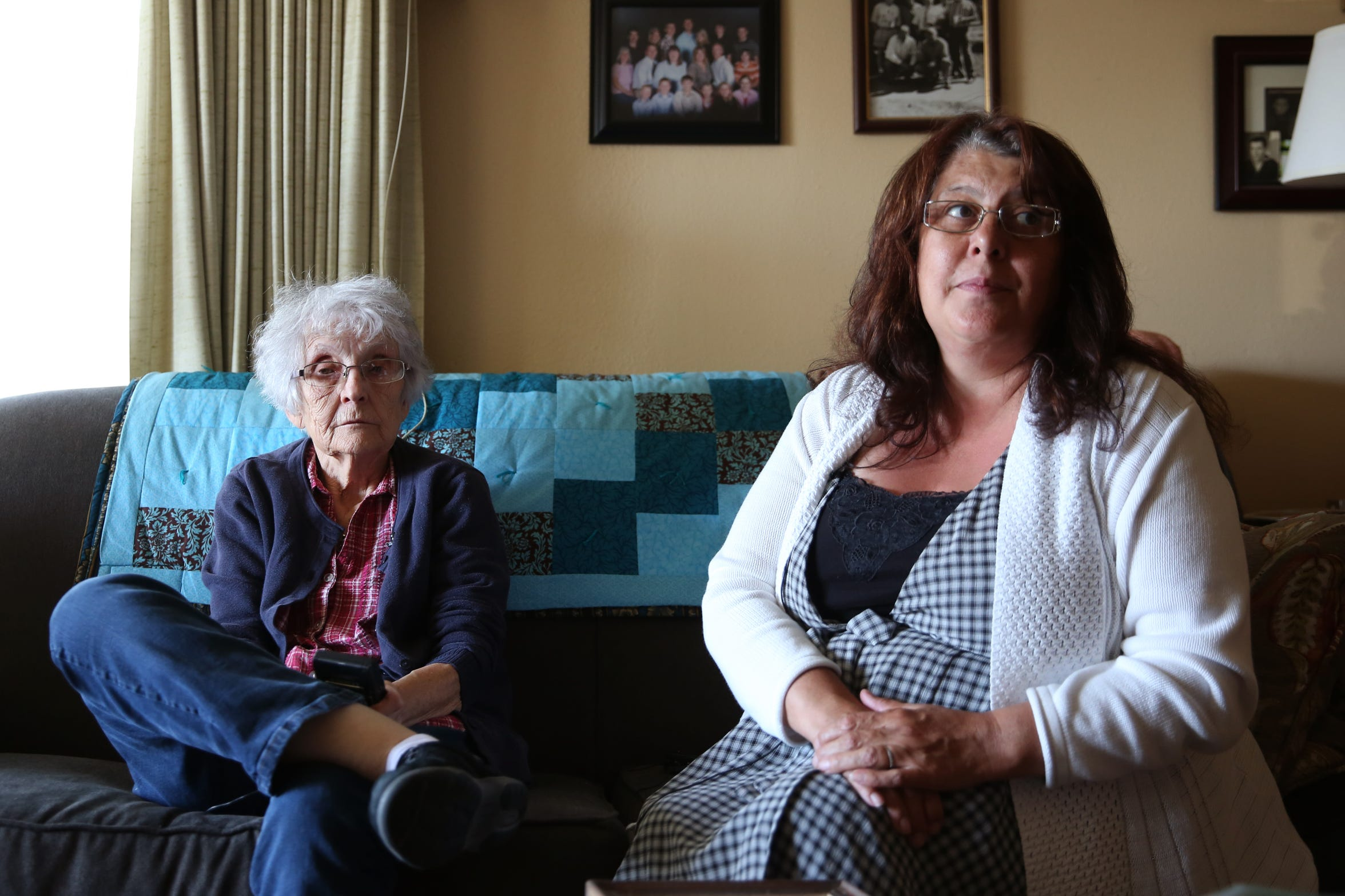 Vicki Morace, left, and her daughter Sharmon Cook-Wright remember their son and brother, respectively, George Cook in Morace's Salem home on Wednesday, July 18, 2018. George Cook died of exposure in November 2017 after being homeless in Salem for years.