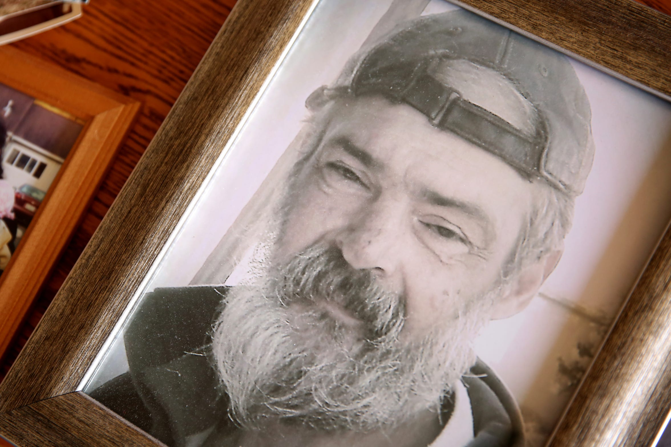 A framed photograph of George Cook, who died of exposure in November 2017 after being homeless in Salem for years. Photographed in his mother's Salem home on Wednesday, July 18, 2018.