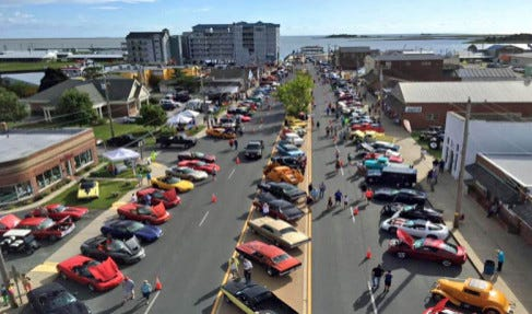 Hot rods and classic cars are lined up at the Crisfield waterfront.
