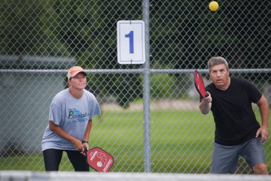 Ladawn Nesje, left, and Tim Christopherson, right, play pickleball at Riverdale Park Thursday, July 19, in Sioux Falls. Pickleball in the Park tournament will be held this upcoming weekend.