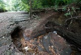 A dry Wilson's Creek revealed the opening's that caused the 'swallow hole'