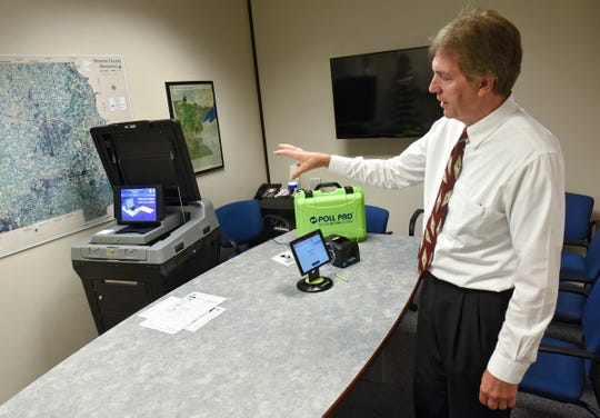 Stearns County Auditor-Treasurer Randy Schreifels talks about the features of new electronic voting technology Thursday, July 19, at the Stearns County Auditor's Office in St. Cloud.