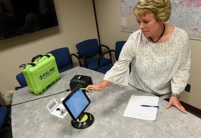 Election specialist Nicole Lahr demonstrates the new electronic poll book system Thursday, July 19, at the Stearns County Auditor's Office in St. Cloud.