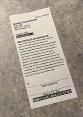 A new voter check-in system generates a form for voters to sign before receiving their ballots.