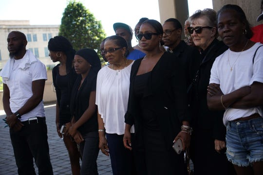 Family and friends gathered outside the Carvel State Office Building on Thursday morning to speak out about the prosecution of 39 people accused of operating a sprawling drug dealing racket.