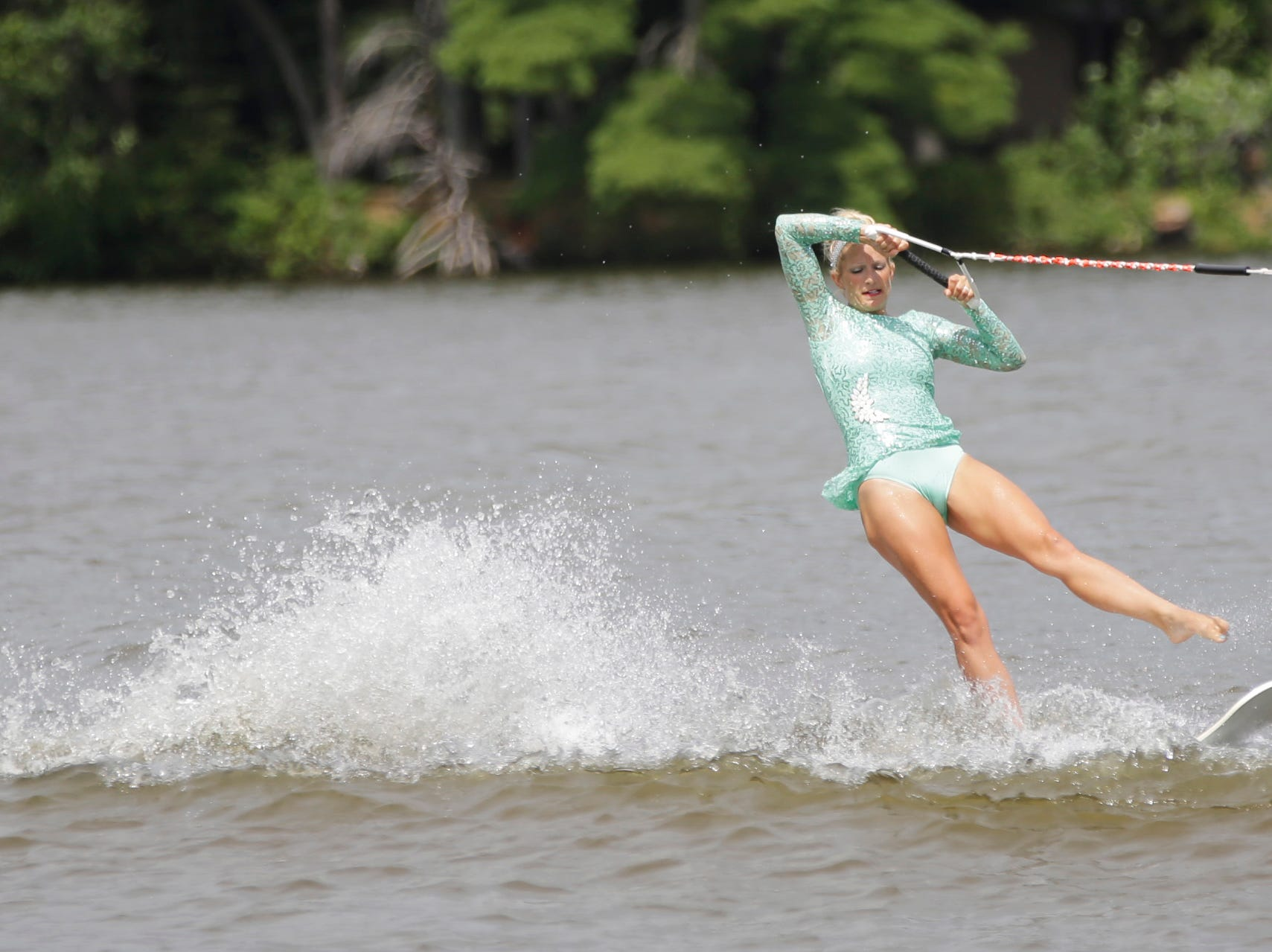 Pam Heineck competes in the swivel category during the Wisconsin State Water Ski Show Championships on Lake Wazeecha in Kellner Thursday, July 19, 2018