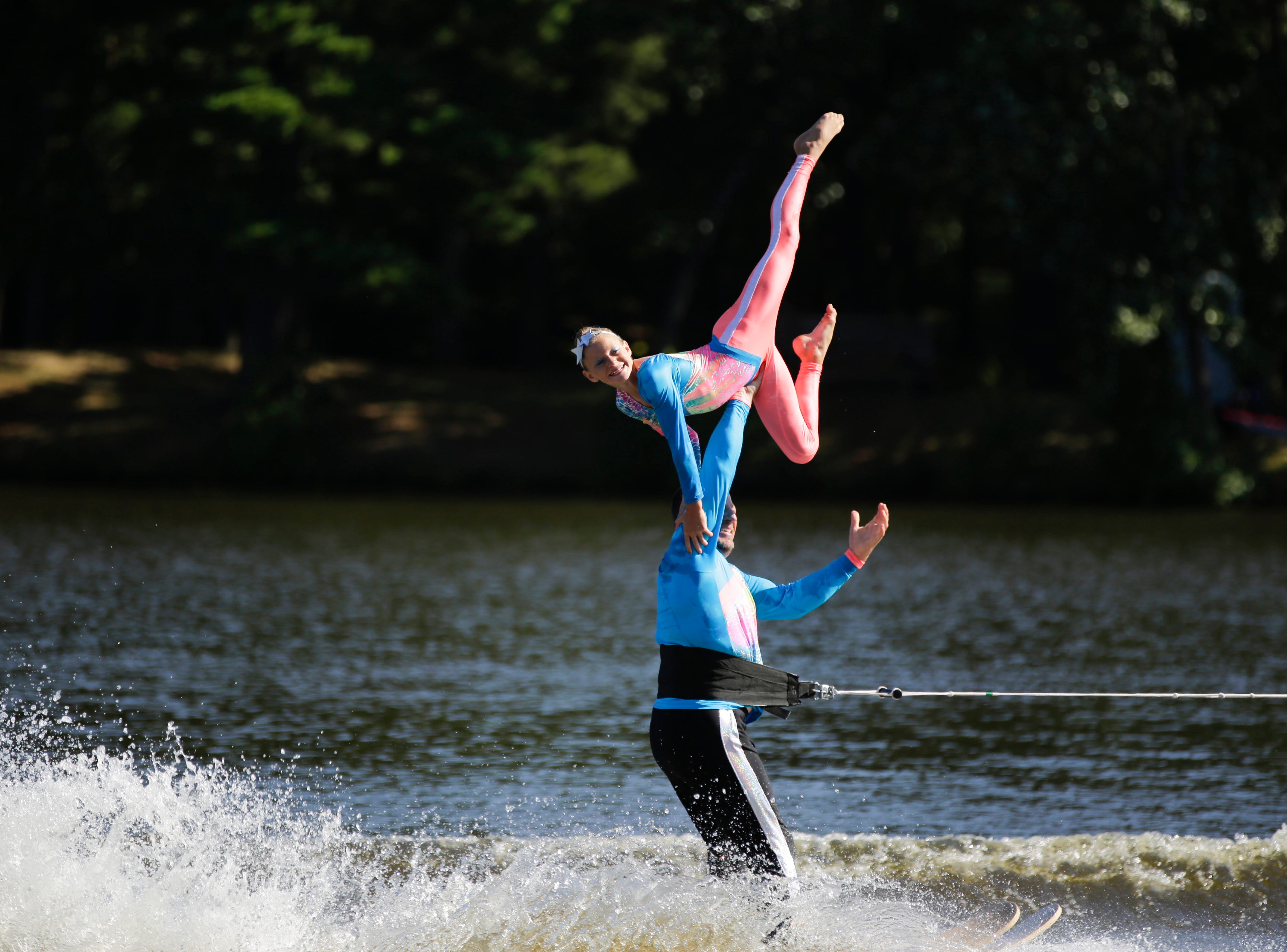 Bear and Sarah Fiedorowicz compete in the doubles category during the Wisconsin State Water Ski Show Championships on Lake Wazeecha in Kellner Thursday, July 19, 2018.