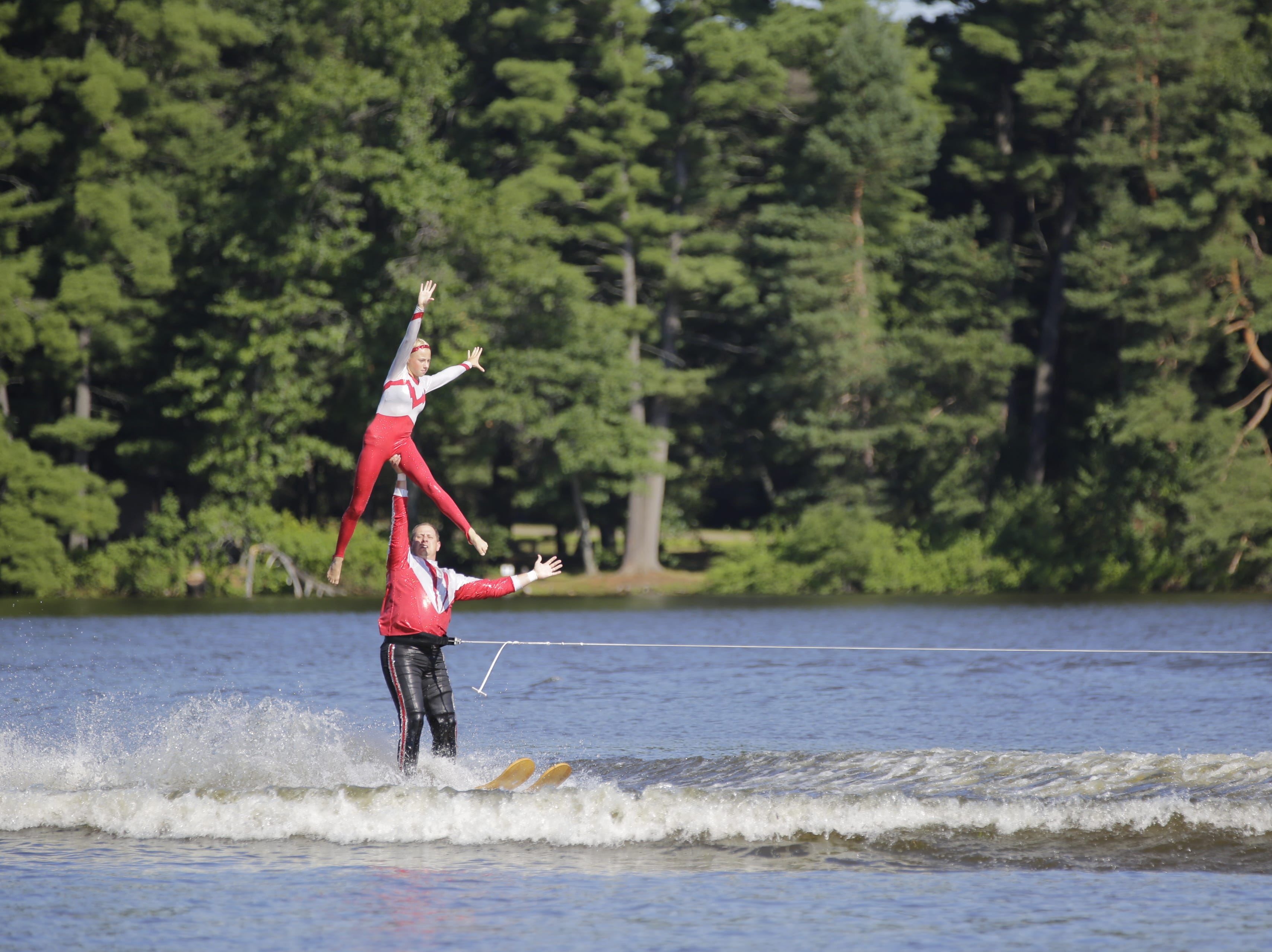 Jon and Lindsay Jossie compete in the doubles category during the Wisconsin State Water Ski Show Championships on Lake Wazeecha in Kellner Thursday, July 19, 2018.