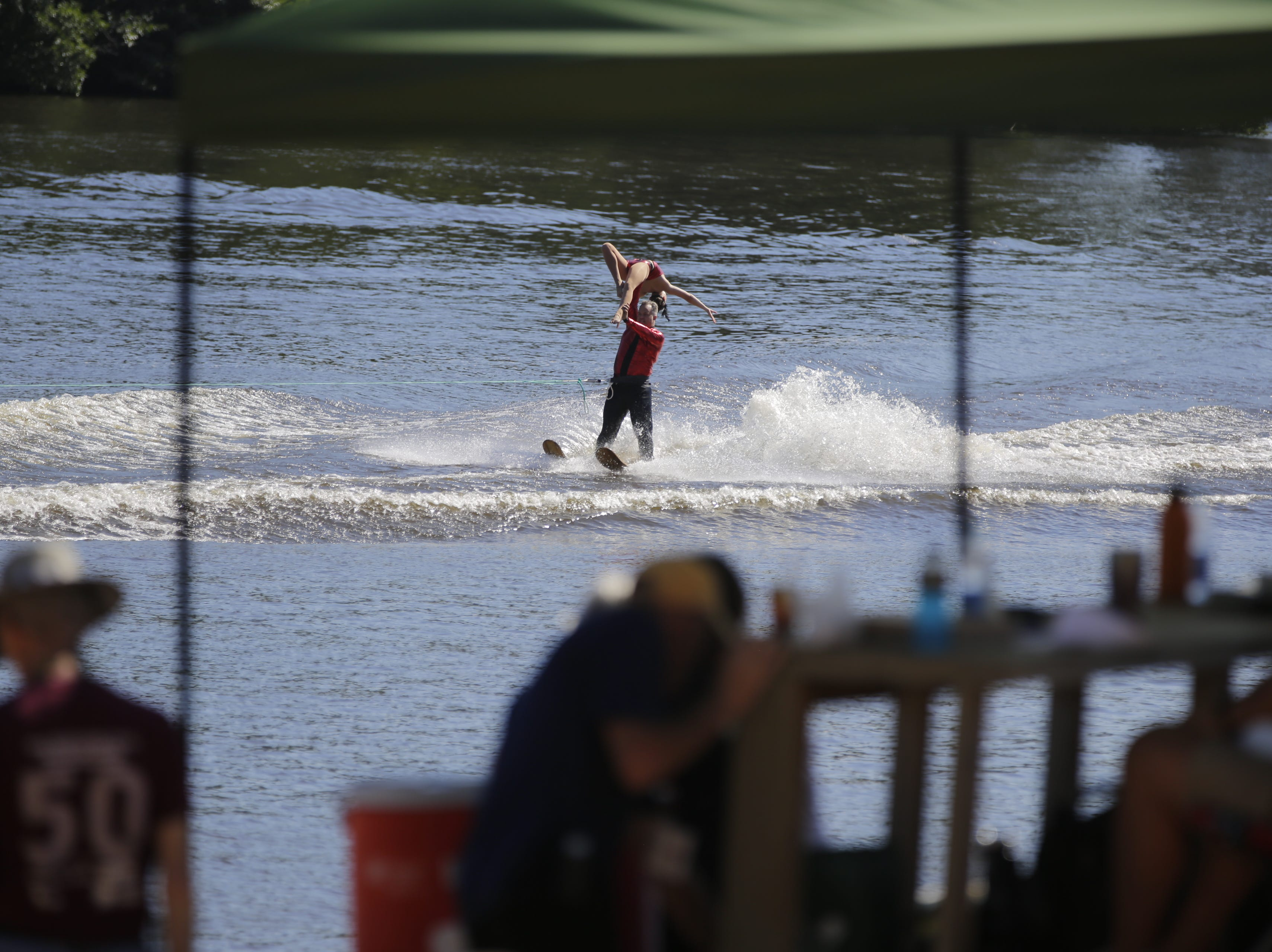 Michael and Megan Bolda compete in the doubles category during the Wisconsin State Water Ski Show Championships on Lake Wazeecha in Kellner Thursday, July 19, 2018.