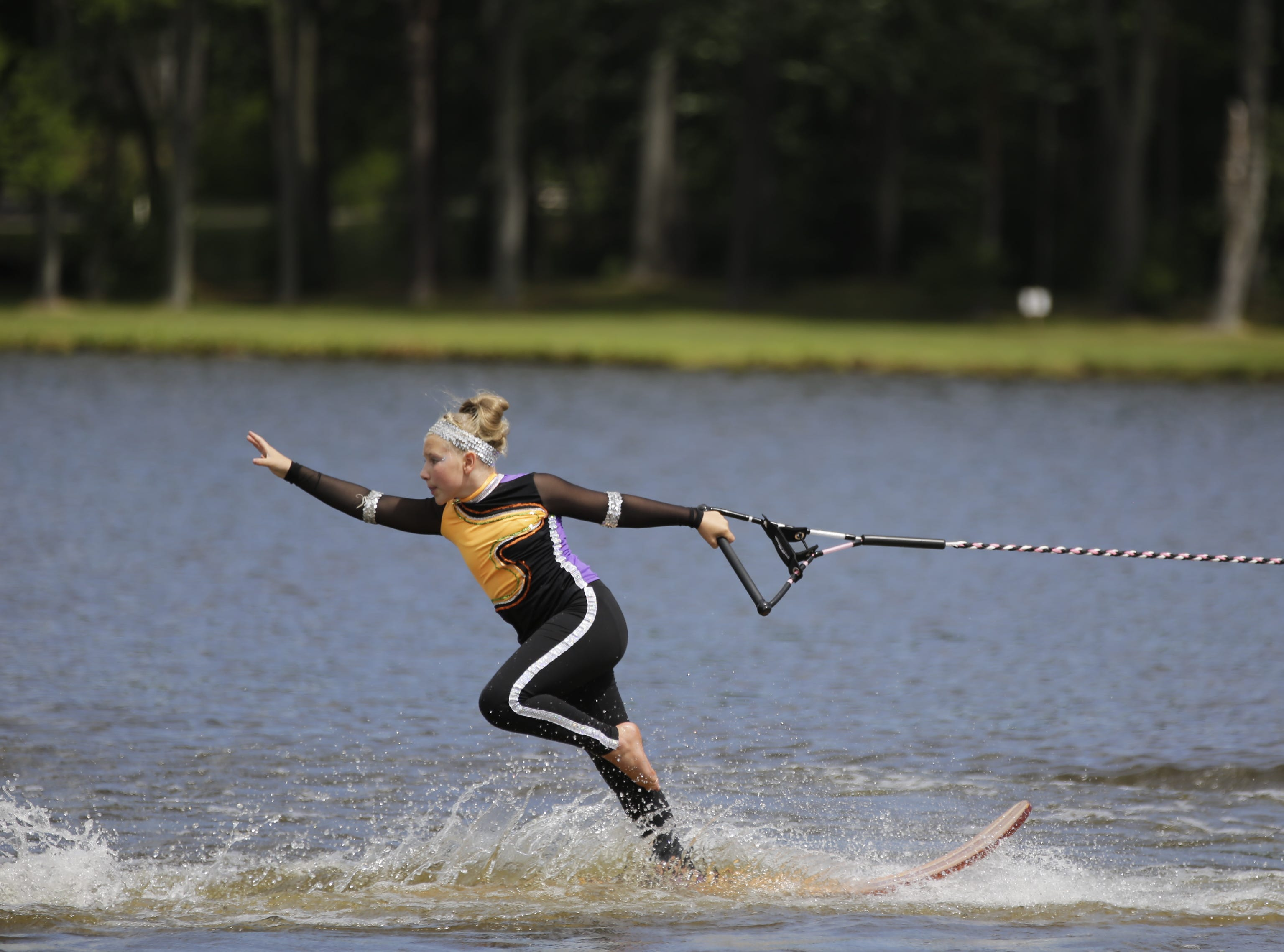 Abby Langer competes in the swivel category during the Wisconsin State Water Ski Show Championships on Lake Wazeecha in Kellner Thursday, July 19, 2018.