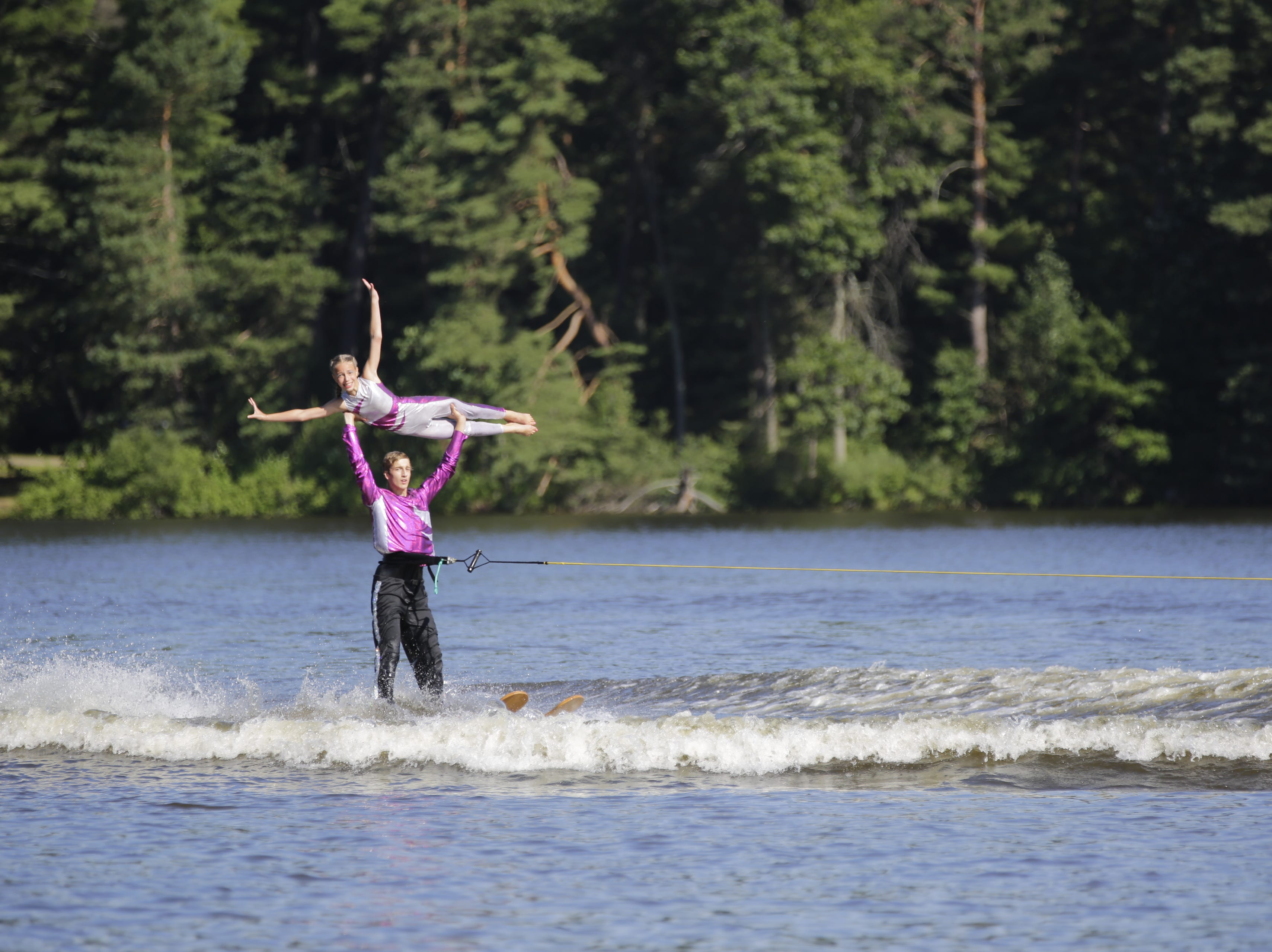 Jacob VanEgtern and Morgan Mueller compete in the doubles category during the Wisconsin State Water Ski Show Championships on Lake Wazeecha in Kellner Thursday, July 19, 2018.