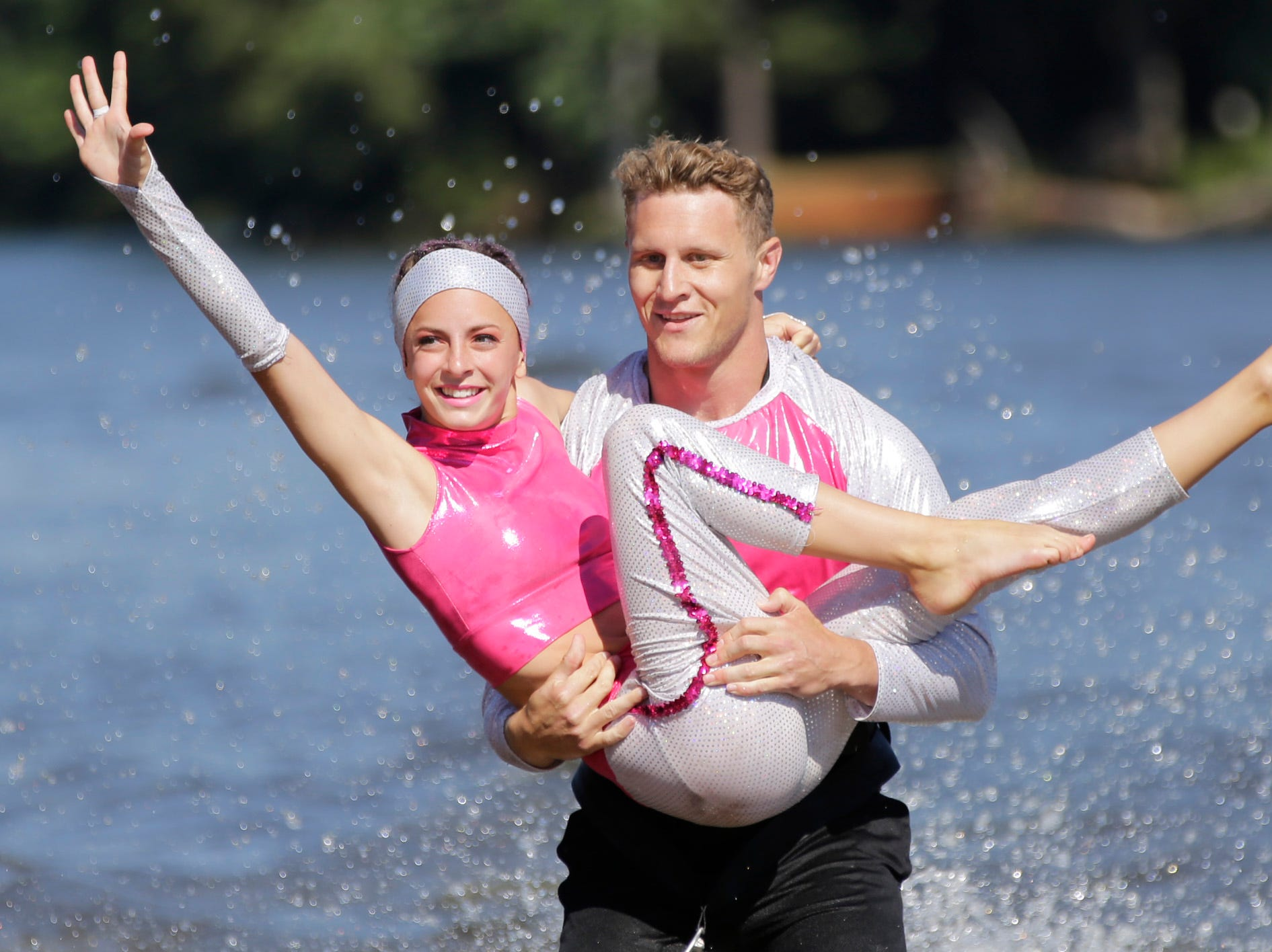 Cody Siolka and Ava Pleshek compete in the doubles category during the Wisconsin State Water Ski Show Championships on Lake Wazeecha in Kellner Thursday, July 19, 2018.