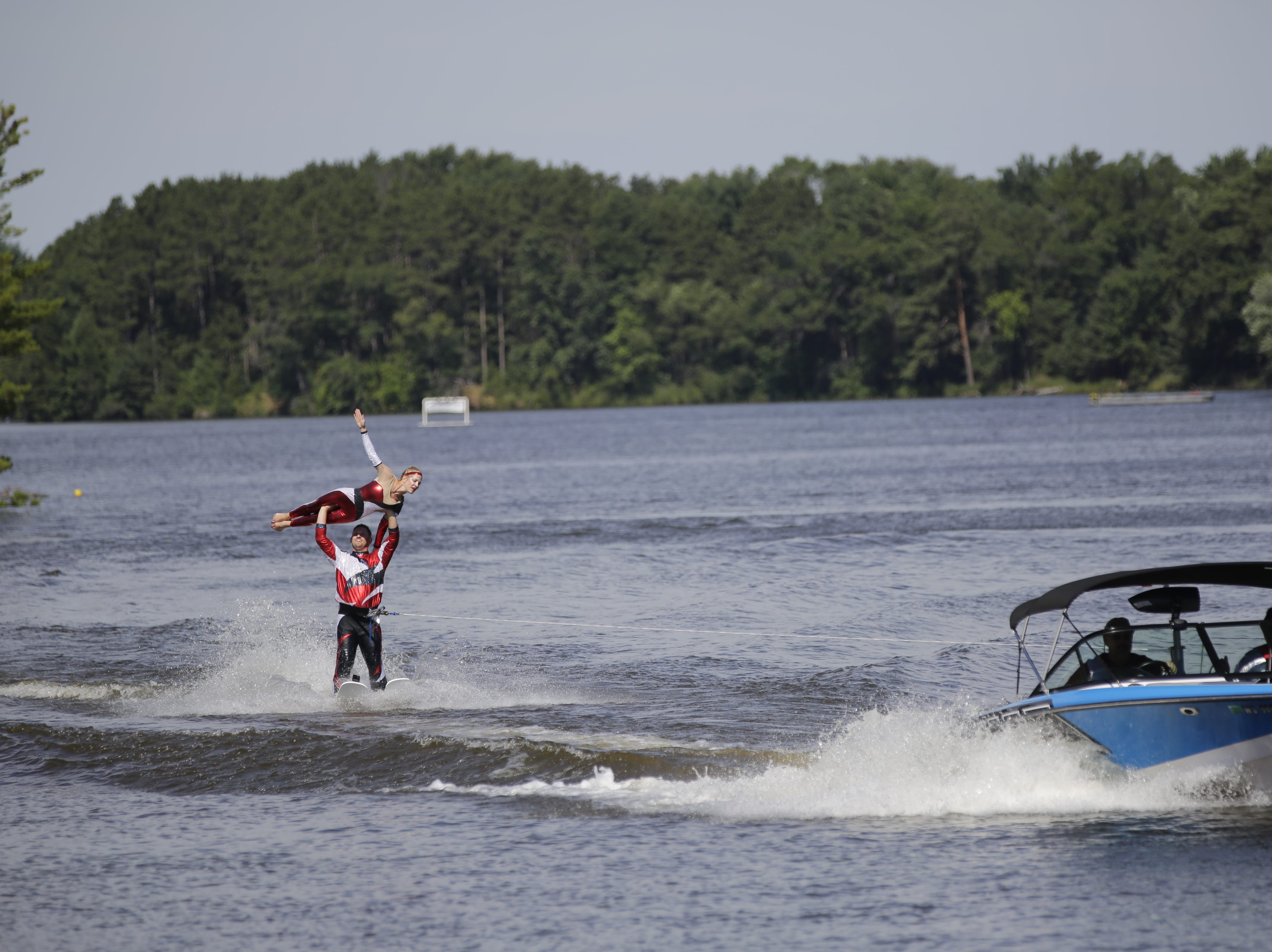 Cory Krivitz and Kimberly Stoner compete in the doubles category during the Wisconsin State Water Ski Show Championships on Lake Wazeecha in Kellner Thursday, July 19, 2018.