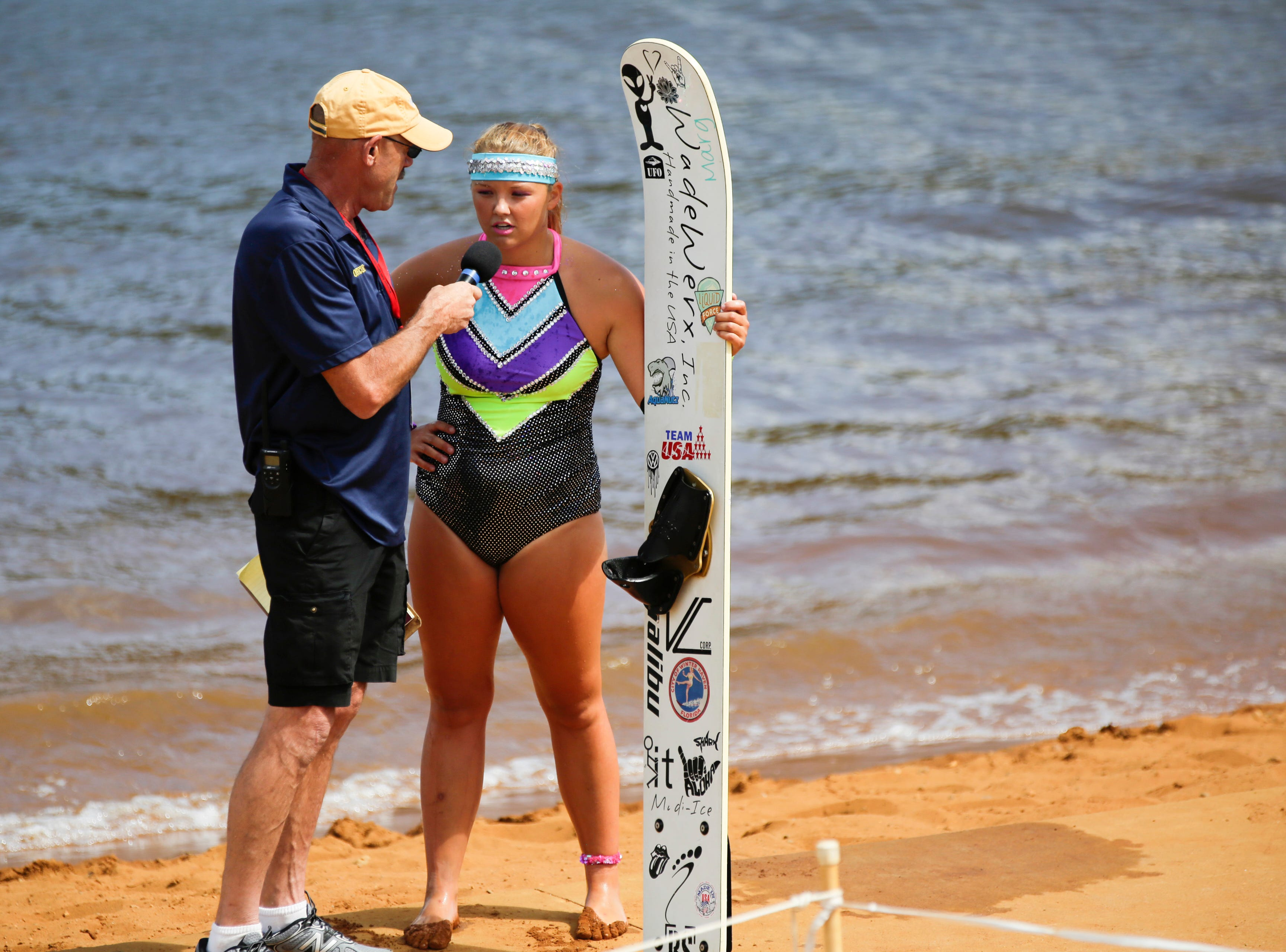 Maddie Hageman talks with the announcer after competing in the swivel category during the Wisconsin State Water Ski Show Championships on Lake Wazeecha in Kellner Thursday, July 19, 2018.